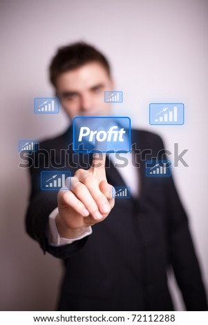 Man pressing Profit icon with one hand - stock photo