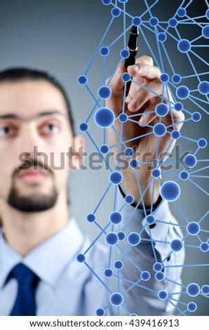 Man pressing virtual buttons - stock photo