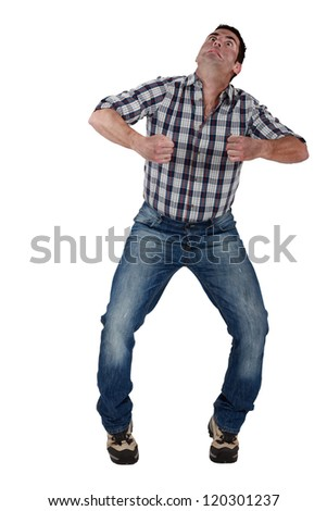 Man pretending to ride horse - stock photo