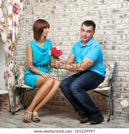 Man proposes marriage to his girlfriend and gives a beautiful bouquet - stock photo