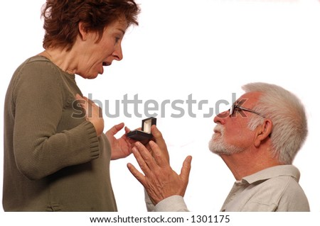 Man proposes on on knee to his love - stock photo