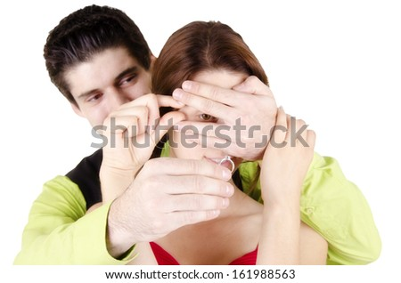 Man proposing engagement ring his woman, on white background. - stock photo