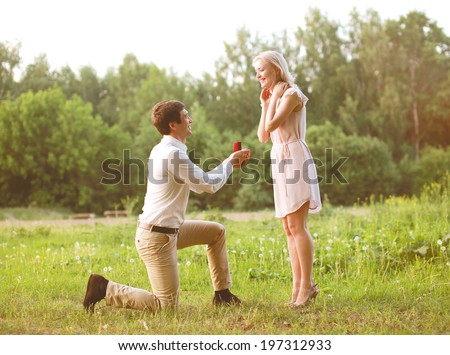 Man proposing ring woman, love, couple, date, wedding - concept - stock photo