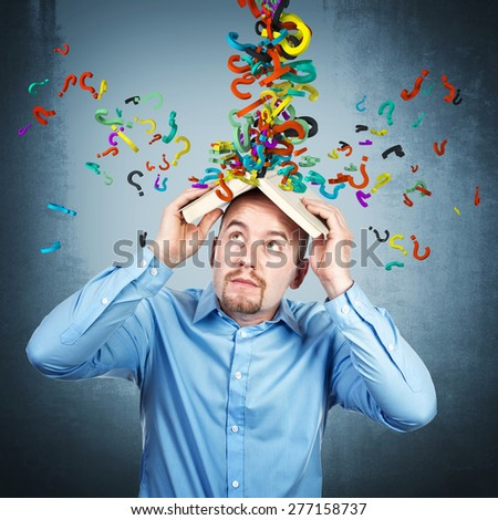 man protection himself from question mark rain - stock photo