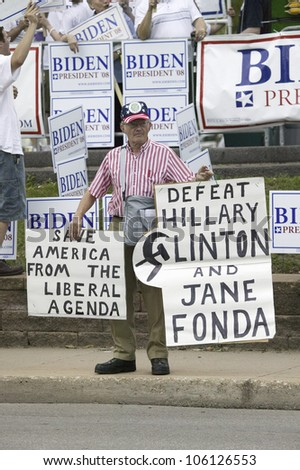 Man protesting US Senator Hillary Clinton during her campaign debate in Des Moines, Iowa, August 19, 2007 - stock photo