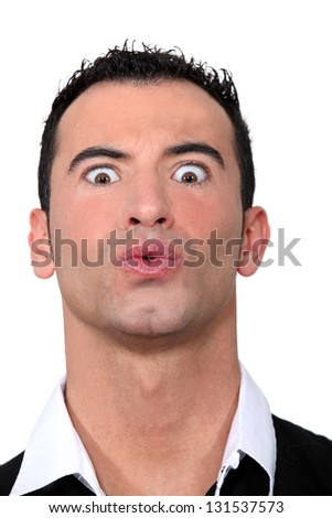 Man pulling a face - stock photo