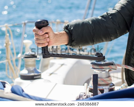 Man pulling a vessel rope. Sailing vessel - stock photo