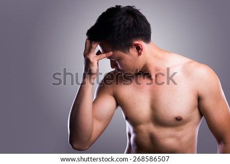 man pulling his hair, making very stressed expression - stock photo