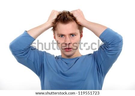 Man pulling own hair - stock photo