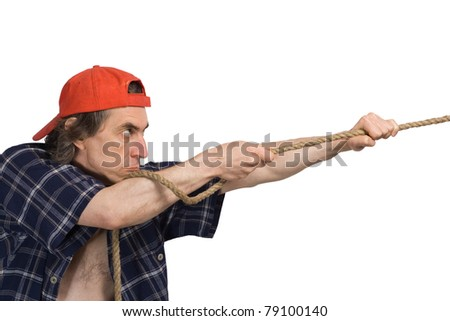 Man pulls a rope. Isolated white background - stock photo