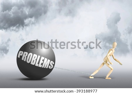 Man pulls hard problems with himself. Conceptual image with a wooden puppet - stock photo