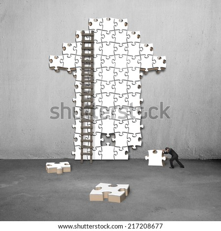 man push puzzle with arrow shape on concrete wall - stock photo