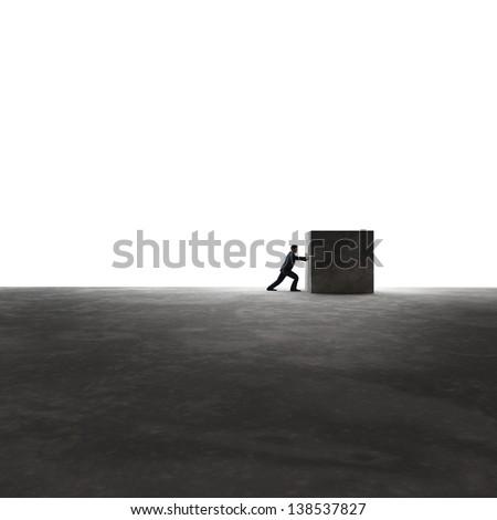 Man pushing a cube - stock photo
