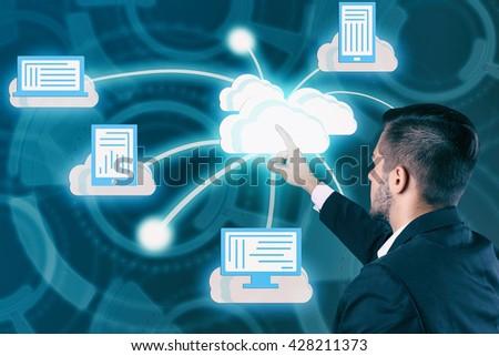 Man pushing touch cloud computing button on virtual screen - stock photo