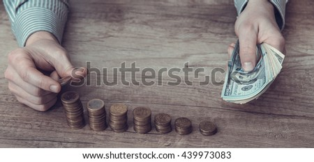 man put coin stack money for money growth concept. toned image - stock photo