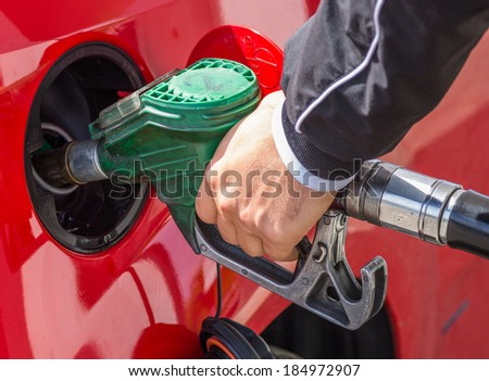 man put some gasoline in the tank - stock photo