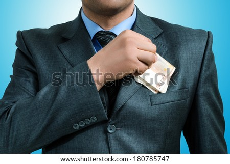 man put the euro in a jacket pocket - stock photo