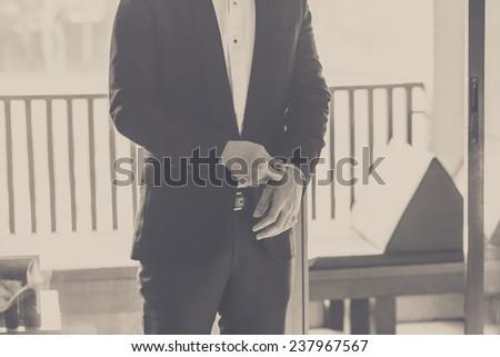 Man putting Button. - stock photo