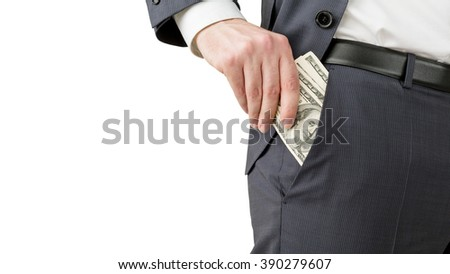 Man putting one hundred dollar banknotes into the pocket. No head seen. Isolated. Concept of earning money. - stock photo