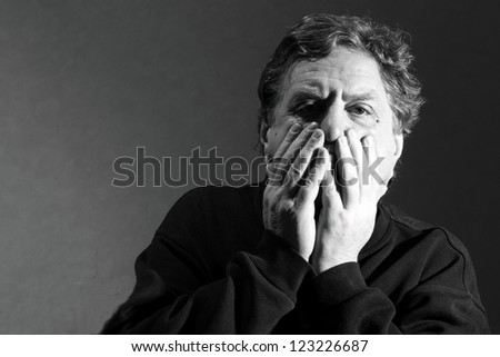 man raised his hands to his face - stock photo
