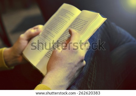 Man reading the book - sepia effect - stock photo