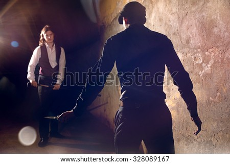 Man ready to fight with knife at urban street - stock photo