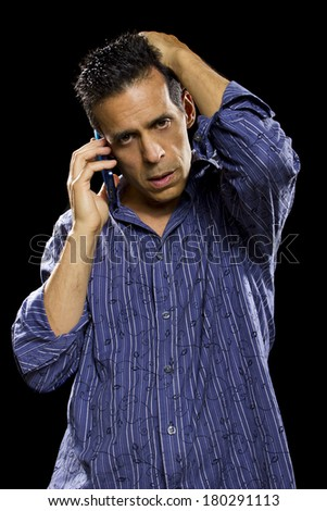 man receiving bad news on the the cell phone - stock photo