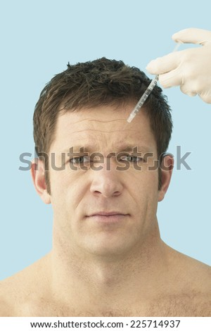 Man Receiving Botox Injection in Forehead - stock photo