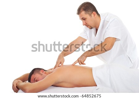 Man receiving Shiatsu massage from a professional masseur at spa salon - stock photo