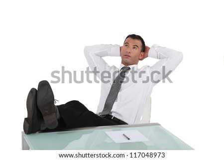 Man reclining in his chair - stock photo