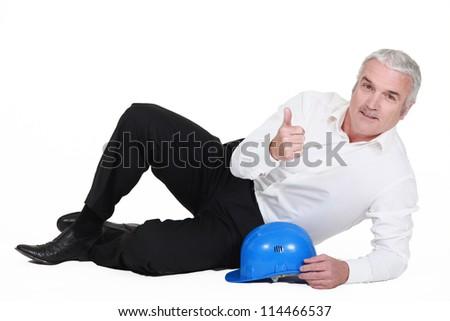 Man reclining on the floor - stock photo