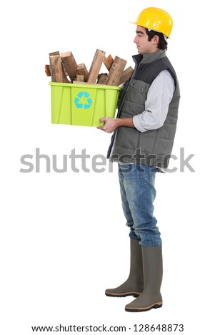 Man recycling wood. - stock photo