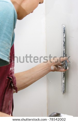 man refit wall - stock photo