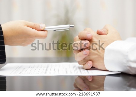 man refusing to sign a document - stock photo