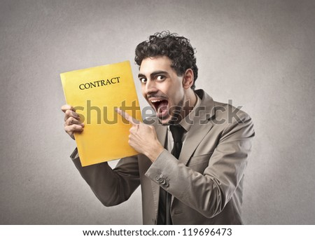 Man rejoicing for a contract - stock photo