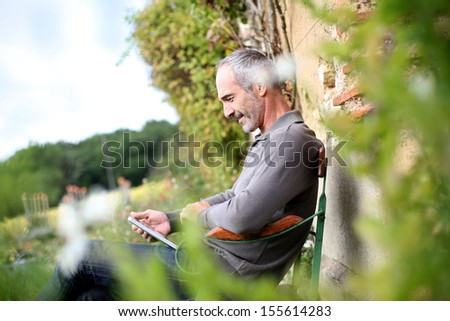 Man relaxing in country house on week-end - stock photo