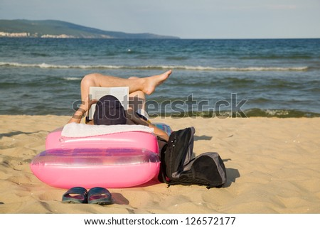 Man relaxing on a beach - stock photo