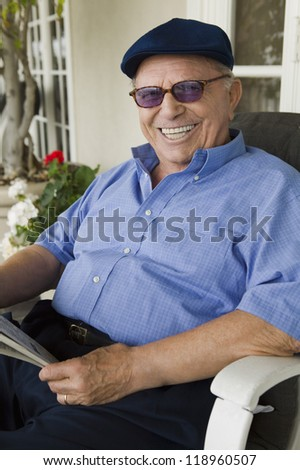 Man Relaxing on Porch - stock photo