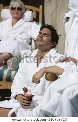 Man relaxing on spa chair - stock photo