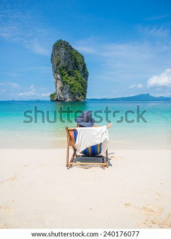 Man relaxing on the tropical beach in Thailand - stock photo