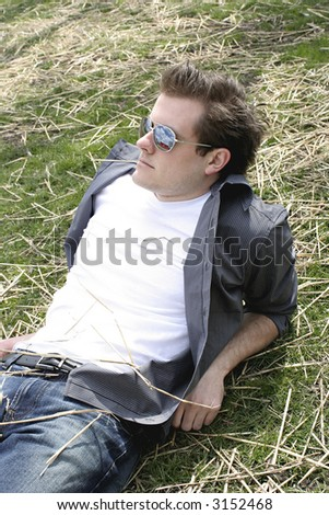 man relaxing on the yard - stock photo