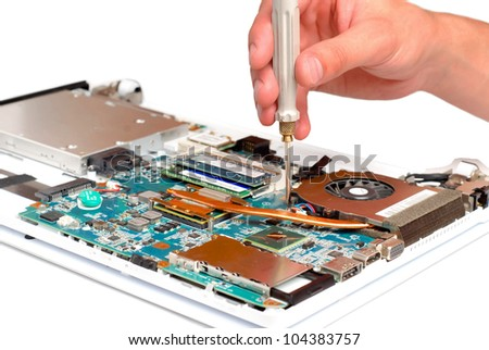 man repair laptop motherboard with screwdriver - stock photo