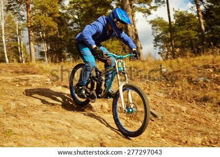 man riding a mountain bike outdoor. extreme sport - stock photo
