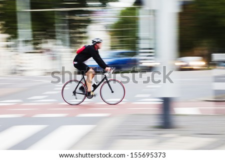 man riding a sport bike in the city traffic in motion blur - stock photo