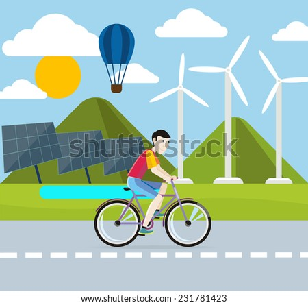 Man riding his bike on the road of environmentally friendly planet.  Eco concept with wind turbine, solar panel, hot air balloon. Raster version  - stock photo