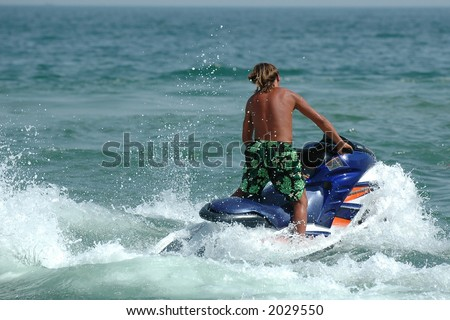 Man riding on his jet-ski - stock photo