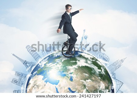 "Man riding unicycle around the globe with major cities concept, ""element of this image furnished by NASA"" - stock photo"