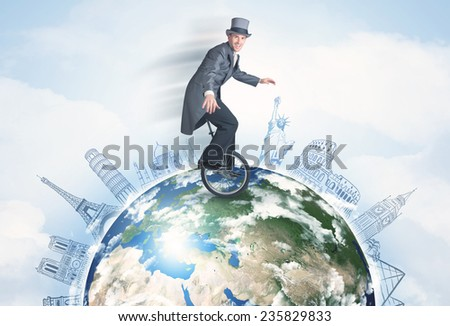 "Man riding unicycle around the globe with major cities concept,  ""Elementsof this image furnished by NASA"" - stock photo"