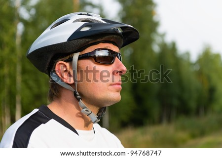 Man rollerskating with the rods. - stock photo