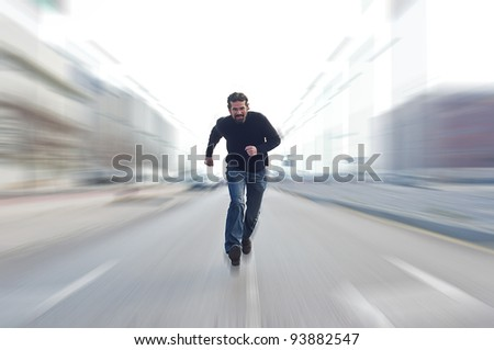 Man running across a road - stock photo